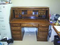Large roll top desk by Riverside furniture. 3 locking