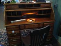 This is an oak veneer roll top desk in excellent health