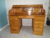 Beautiful light oak roll top desk for sale. This desk
