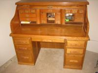 "Large roll-top oak desk (29"" deep  X  54 "" wide X 47 """