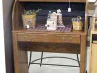 G & B Used Furniture has a roll top desk for sale. We