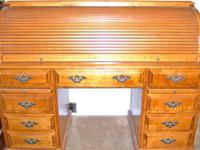 Roll top desk in very good shape. We are moving and I