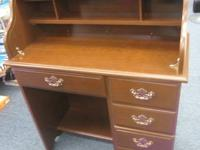 Roll top desk in very good shape. We are moving and