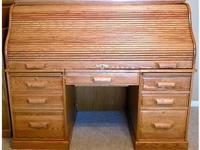 What we have for sale is an Oak Roll Top Desk. It was