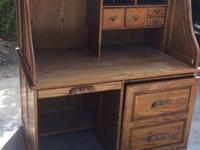 Roll Top Desk in good condition, it is oak. The varnish
