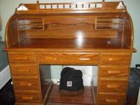Roll Top Desk $75. Book case $25, Rattan Baler's Rack