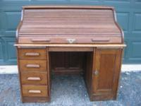 Selling a very nice Antique Roll Top desk in excellent