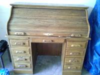 Very nice kept condition roll top desk. Both huge