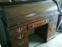 We have a rolltop secretary desk in excellent