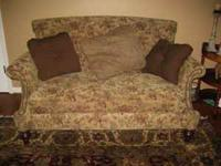 Rolled back settee style sofa with nailhead trim made