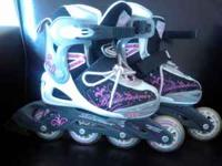 Two pairs of Roller Blades. Pink and white, size 4.