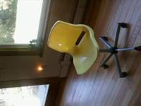 Yellow and black rolling chair for computer/desk. Kids
