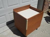 This walnut-veneer library cart holds lots of books and