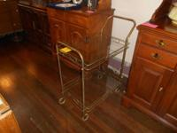 We are selling this BEAUTIFUL Rolling Tea Cart! We are