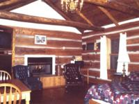 Ou getaway cabin has cathedral ceilings, wide pine