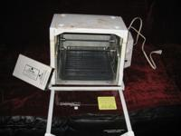 Here we have a White Ronco Compact Rotisserie BBQ Oven,