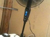 Oscillating 16 room fan with remote control. Black