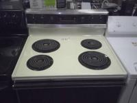 This is a USED Roper electric stove almond/eggshell in