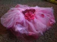 I am selling this rose tutu with petals in the toole