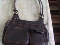 This is a genuine leather Rosetti Brown Handbag (carry