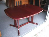 "59"" long X 39"" wide X 29"" tall. With center leaf  table"