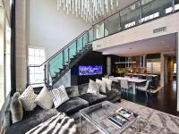 This truly one-of-a-kind, two-level condo at Gaslight