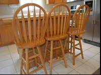 Five good quality, RC Willey oak bar stools for sale.