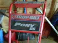 used 1 year, electric start Troybilt rototiller pony