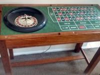 This solid oak combination Craps table, roulette wheel