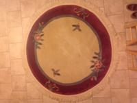 "Round area rug that measures between 70-72"" with fringe"