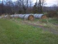 "Mixed grass hay net wrapped, bales are 4'4"" wide by 4'"