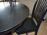 """This round table is 42"""" in diameter, solid and sturdy."""