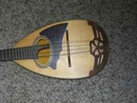 Very nice round bottom mandolin that sounds great,