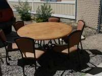 Round dining or card table with 6 chairs, plus spare