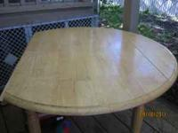 Blonde wooden childrens table. Side fold down. Good