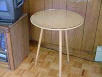 "20"" three legged decorative table with round glass top."