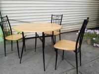 GREAT CONDITION!! We have a Dining Table with 4