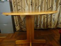 Round wooden dinner table with extension. Full size