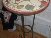 This is a beautiful small round table for use as an end