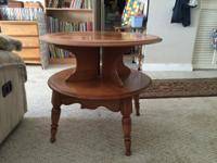 This Vintage round end table is maple wood. It has been