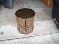 "Table is 18"" diameter, 20"" tall, two doors, smoked"