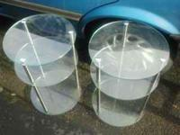 I have two round glass end tables with silver frame for