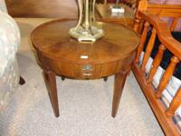 This is a gorgeous round table made by JOHN WIDDICOMB.