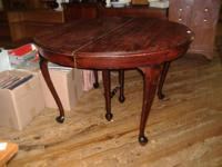We are selling a round mahogany Queen Anne dining room