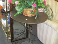 Round metal and iron decorative side table. Measures