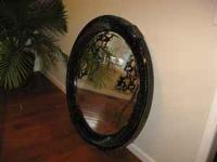 Round mirror. Has faux crackle finish. Measures 43""
