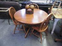 Oak dining table and 4 chairs. $150.00 YES!!! We accept