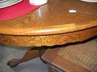 Round oak table. Claw feet. Very pretty. No leaf.