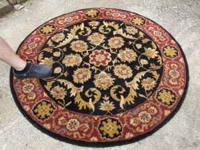 Lovely large round oriental rug, I'm assuming at least