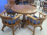 Round Pine Pedestal Table with 4 Captains Chairs on